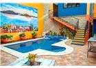 AJIJIC CENTRO, 3rec, 1baños, 2planta, 394m2 Constr, 364m2 Terr, US$599,000.-, this recently profe ionally renovated and decorated jewel is an oasis right in the heart of ajijic village (easy acce to the malecón and ajijic s many shops and restaurant), and offers many different living options. the main house features a custom-built dream kitchen complete with quartz countertops, parrota wood cabinets, reverse osmosis water system and whirlpool appliances. to the right, there is one of the two living rooms, cozy and bright. the the left of the kitchen you will find a formal dining room, which flows into the second high-ceilinged living room, boasting a water fountain and fireplace. the main bedroom suite is situated on the second floor, with walk-in closet, a generous bathroom, a laundry area and an office nook, as well as two terraces. . . the outside areas are designed for easy maintenance, giving you lots of time to enjoy the completely private solar heated swimming pool with its swim jet system facing a beautiful mural. . . . . the casita has its own entrance from the entry pathway, and can also be acce ed from the main house s second living room. the casita offers two bedrooms and one bathroom (with jetted bathtub), a full kitchen, dining/living area and a laundry room. whether for guests, multi-generation living or as a first floor master suite, this layout gives you a myriad of options. . . above the garage with its automatic gate, sits a wonderful flex room, it could be used as an artist studio, gym, office or could be converted into a fourth bedroom. a staircase leads up to the mirador with lovely views of the village and the lake and mountains beyond. . . this bright and airy home was completely renovated to the highest standards in 2020, including custom lighting throughout. four zones of the home have minisplit air-condition units, providing both heating and cooling. since the home has a full solar electric system, you can use them to your heart s content